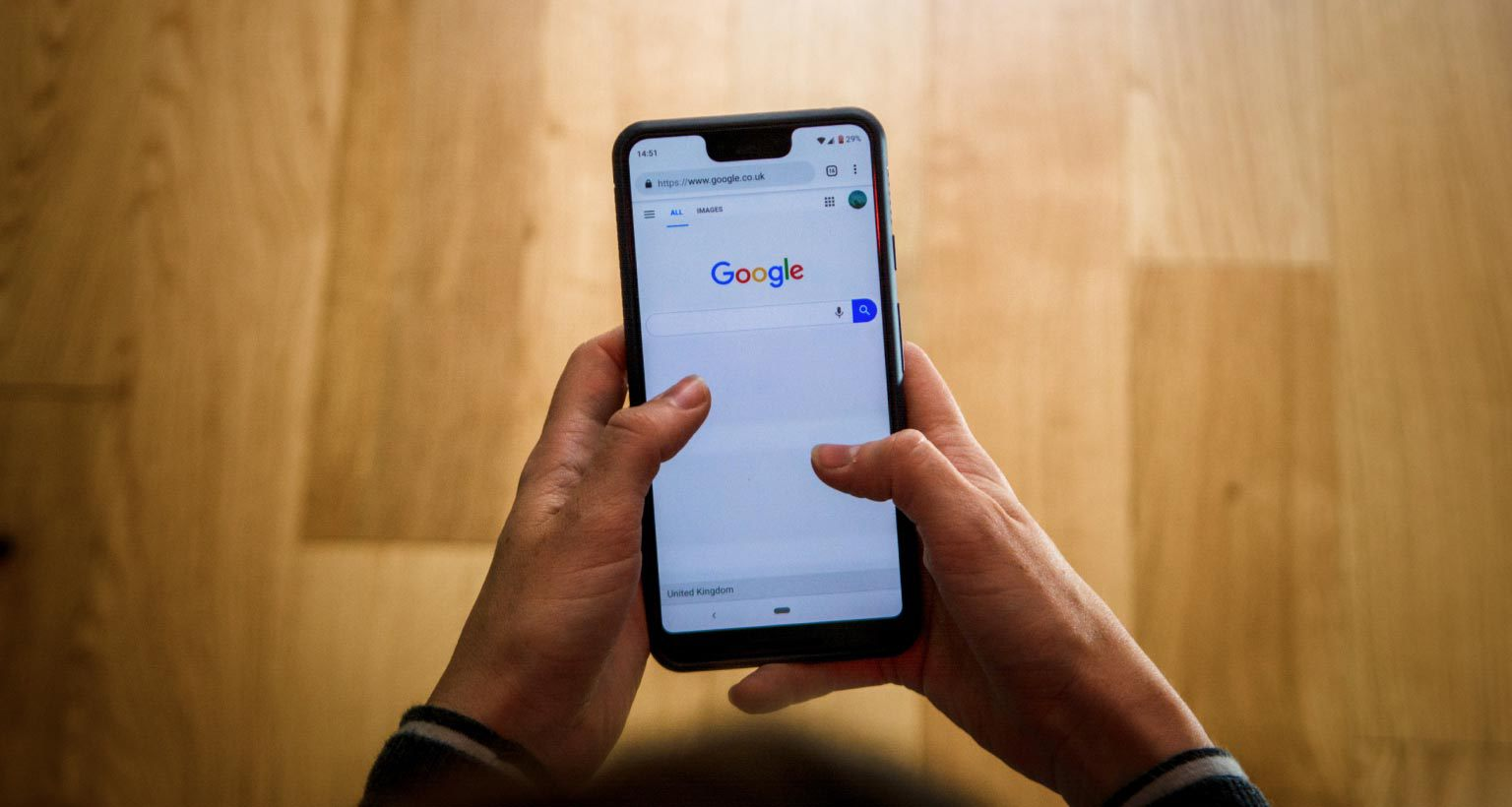 person looking at google on a smart phone