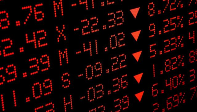 screen showing stock market prices in red